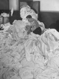 Laundryman Standing Thigh Deep in Daily Ocean of Soiled Bedding at the Waldorf Astoria Hotel Premium Photographic Print by Alfred Eisenstaedt
