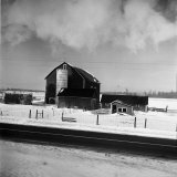 Barn and Farm Buildings in Snow, as Seen from Train Window Photographic Print by Walker Evans