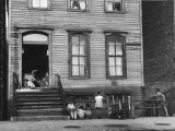 African American Children on Sidewalk in Front of a Tenement Building in the Slums of Chicago Premium Photographic Print by Gordon Coster