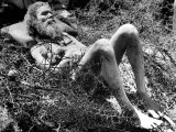 Indian Fakir Sleeping on a Bed of Thorns as He Shuns Pain While Practicing His Religious Asceticism Premium Photographic Print by Margaret Bourke-White