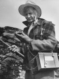 Uranium Prospector Clarence Cody Using Homemade Geiger Counter Premium Photographic Print by Francis Miller