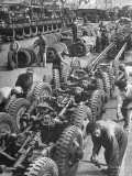 French Army Mechanics Busy Assembling Tires on the Chassis of 3/4 Ton American Made Army Trucks Premium Photographic Print by Margaret Bourke-White