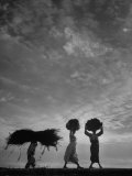 Korean Peasants Carrying Bundles on Their Heads Photographic Print by Michael Rougier