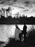Nancy Stallworth and Emil Tolimieri Holding Hands on Tombigbee River Below Ante Bellum Mansion Premium Photographic Print by Alfred Eisenstaedt