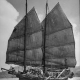 Junk Leaving Harbor with Patchwork Sails Up Photographic Print by Jack Birns