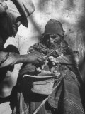 Beggar Being Given Coca Leaves Premium Photographic Print by Eliot Elisofon