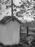 Small Child Running to the Outhouse at Rural School Photographic Print by Thomas D. Mcavoy
