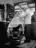 Elderly Barber Cutting Young Man's Hair Premium Photographic Print by Yale Joel