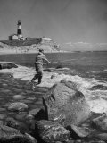 Man Fishing Off Montauk Point. Montauk Lighthouse Visible in Background Premium Photographic Print by Alfred Eisenstaedt