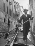 Gondolier Maneuvering Through Small Canal Premium Photographic Print by Alfred Eisenstaedt