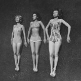 Three Sun Bathers Soaking Up Rays Photographic Print by Allan Grant