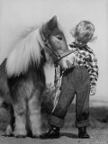 Child Standing Beside a Miniature Horse, Showing Size Comparison Premium Photographic Print by Ed Clark