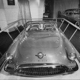 Sleek New Oldsmobile Starfire Standing in Show Room Photographic Print by Eliot Elisofon
