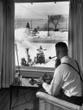Man Operating Remote Control Snow Plow Premium Photographic Print by Joe Scherschel