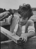 12 Year Old Boy with a Perceptual Handicap, Using Hammer in Backyard of His Home Premium Photographic Print by Grey Villet