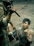 Bayonet Wielding South Vietnamese Soldier Menacing Captured Viet Cong Suspect During Interrogation Premium Photographic Print by Larry Burrows