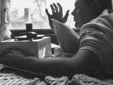Boy Listening to Music on Phonograph in His Bedroom Premium Photographic Print by Gordon Parks