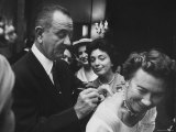 Lyndon B. Johnson Signing Card on Woman's Back as Mrs. Burton Joseph Watches Premium Photographic Print by Stan Wayman