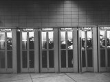Busy Telephone Booths During an Airline Strike Premium Photographic Print by Robert W. Kelley
