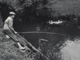 Boy Fishing in Pond Premium Photographic Print by Jerry Cooke