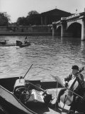 Man Playing Cello on Boat Premium Photographic Print by Loomis Dean