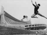 Gymnasts Outside the New Olympic Building in Japan Premium fotoprint van Larry Burrows