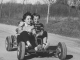 Joann Lumbert and Friend Annette, Take Ride in a Go Cart Impresso fotogrfica premium por George Silk