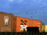 Line of Box Cars Dramatically Lit by Late Day Sunlight Premium Photographic Print by Walker Evans