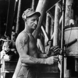 Man Working in a Shipyard and Taking a Break For Coffee Photographic Print by George Strock