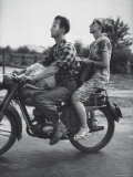 Man and Woman Riding on Motorcycle Premium Photographic Print by Jerry Cooke