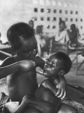 Biafran Child Feeding Another Child Premium Photographic Print by Terence Spencer