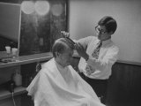 Gov. Jimmy Carte Receiving a Hair Cut Premium Photographic Print by Stan Wayman