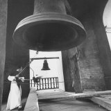 Monk Ringing Bell in Plaza de Armas Photographic Print by Frank Scherschel