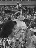 Festival Queen Julie Pratt Standing Next to Trophy Premium Photographic Print by Stan Wayman