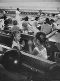 Children Entertaining Themselves While Their Mothers Compete in Bowling League Premium Photographic Print by Stan Wayman
