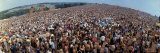 Wide Angle Overall of Huge Crowd Facing the Distant Stage, During the Woodstock Music and Art Fair Reproduction photographique par John Dominis