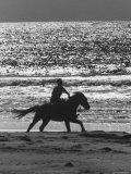American Visitors Enjoying Horseback Riding on Rosarita Beach Photographic Print by Allan Grant