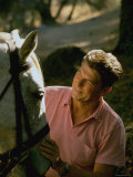 Actor and California Gubernatorial Candidate Ronald Reagan Petting Horse Outside on Ranch at Home Premium Photographic Print by Bill Ray