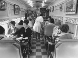 Customers Inside Neal's Diner Premium Photographic Print by Yale Joel