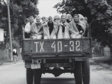 Farm Girls Riding in a Truck Premium Photographic Print by Jerry Cooke