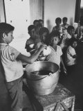 Lunchtime in a the Roman Catholic Mission School in Puerto Asis Premium Photographic Print by Art Rickerby