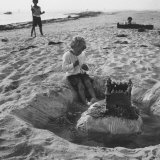 Kid Playing in Sand Photographic Print by Martha Holmes