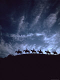 Silhouetted Cowboys During Round Up at Trinchera Ranch Premium Photographic Print by Loomis Dean