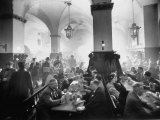 The Hofbrauhaus with Patrons Sitting at Long Tables Holding Large Steins of Beer Photographic Print by Ralph Crane