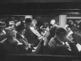Commuters Reading on the Train Photographic Print by Walter Sanders