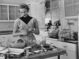 Attractive Housewife in Modern Kitchen, Preparing Food Premium Photographic Print by Eliot Elisofon