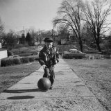 Six Years Old Teddy Cox Practicing His Basketball Dribbling During His Travel to School Photographic Print by Francis Miller