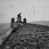Farmer Plowing with a Tractor on an Iowa Farm Photographic Print by Gordon Parks