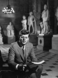 Senator John F. Kennedy Seated in Museum with Statues Premium Photographic Print by Hank Walker