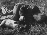 Boy Playing with His Pet Dog Premium Photographic Print by Ed Clark